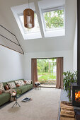 Modern, double-height living room with skylights