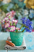 Agapanthus and carnations in turquoise beaker