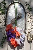 Bouquet of sweet peas on silver dish