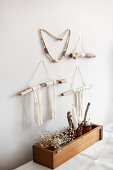 Bohemian-style wall hanging made from sticks and woollen yarn