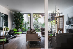 Living room in earthy shades with access to courtyard garden
