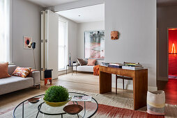 Folding wall and designer furniture in living room