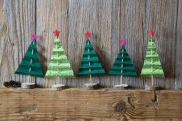 Festive arrangement of handmade paper Christmas trees