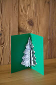 Handmade Christmas card with pop-up motif made from sheet music