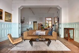 Living room and dining room with pale blue panelled wainscoting