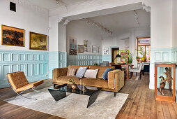 Living room and dining room and pale blue panelled wainscoting