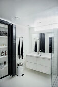 Fitted cupboard in black-and-white bathroom