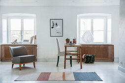 Simply furnished period interior with white floor and window niches