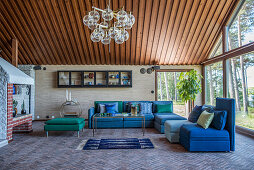 Modular sofas and chairs in shades of blue and green in living room
