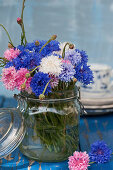 A bouquet of mixed-color cornflowers