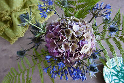 Bouquet of agapanthus, hydrangea, sea holly and fern leaves