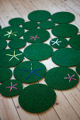 Rug made from green circles of different sizes with star motifs