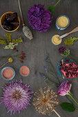 Elements for making an autumn arrangement: chrysanthemum, hydrangea, allium, rose, poppy seed head, rose hips, sea lavender and oak leaves