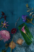 Flowers for making an autumn arrangement: chrysanthemum, calla lily, gerbera daisy, monkshood, eucalyptus, clematis, kangaroo paw and sea lavender