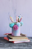 Tin can decorated and repurposed as pen holder