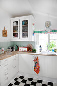 Country-house kitchen with retro accessories and chequered floor