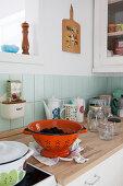 Vintage-style colander and kitchen utensils