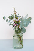 Posy of eucalyptus, sea holly and waxflower