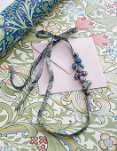 Floral fabric necklace with covered buttons