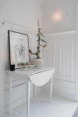 Drop-leaf table against panelled wainscoting in white living room