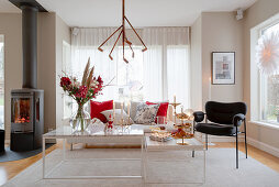 Slender coffee table in modern living room decorated for Christmas