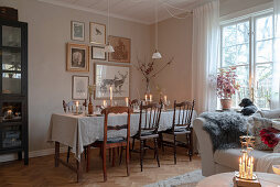 Dining table festively set for Christmas in living room