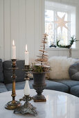 Vintage candlesticks and Christmas decorations on coffee table