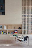 Latticed living room wall and organically shaped table
