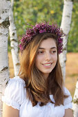 Young woman wearing wreath of heather and sea lavender