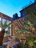 Twilight atmosphere in small, imaginatively designed courtyard garden