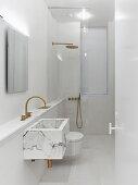 Marble sink and walk-in shower in white, modern, minimalist bathroom