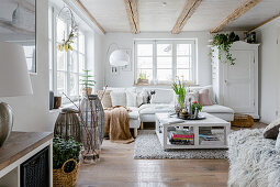 Cosy white living room with rustic accessories