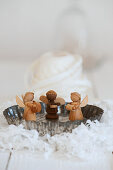 Wooden angels in a small baking pan