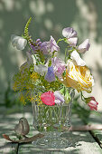 Bouquet of rose blossoms, sweet peas, obedient plant, and dill