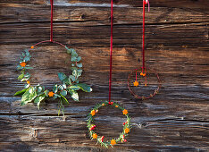Scented wreaths decorated with shapes cut out of orange peel