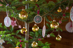 Handmade Christmas-tree decorations and golden baubles
