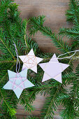 Christmas-tree decorations handmade from paper and yarn