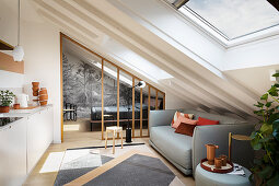 A light grey sofa in a modern kitchen in an attic room