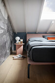 A double bed in an attic bedroom