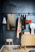 Coat rack with mirror above lowboard
