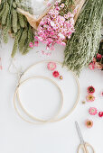 Materials for a spring wreath: wooden hoops and dried flowers