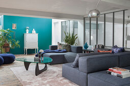 A grey upholstered suite and a coffee table in a lounge area