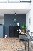 An armchair, a side table and a highboard in a loft apartment