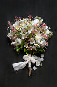 Posy of dappled willow and jasmine tied with fabric bow