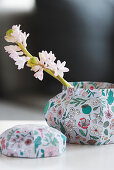 White hyacinth in box covered with paper on coffee table