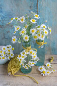 Arrangements and small wreath of chamomile flowers