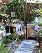 Comfortable seating area on shabby-chic terrace