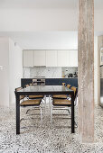 Dining room and kitchen with terrazzo floor