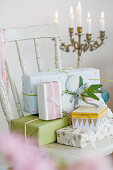 Wrapped gifts in pastel on an old chair