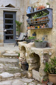 Bricked planting tables with water tap and galvanized tubs